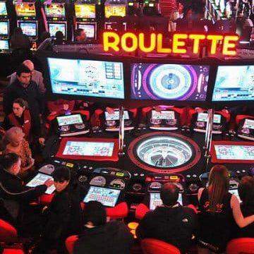 Picture of gamblers inside Casino Marina del Sol.