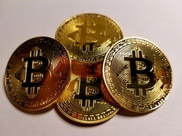 A picture of several medallions representing Bitcoin, which is an electronic medium of exchange favored among online gamblers.