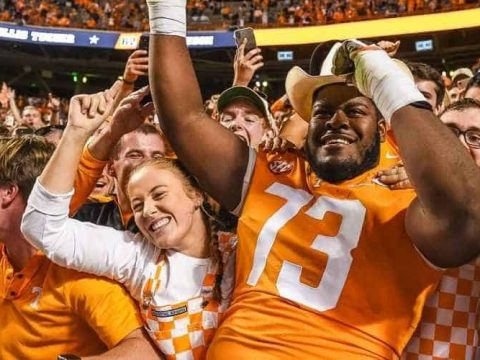 tennessee volunteers football player in the stands with fans